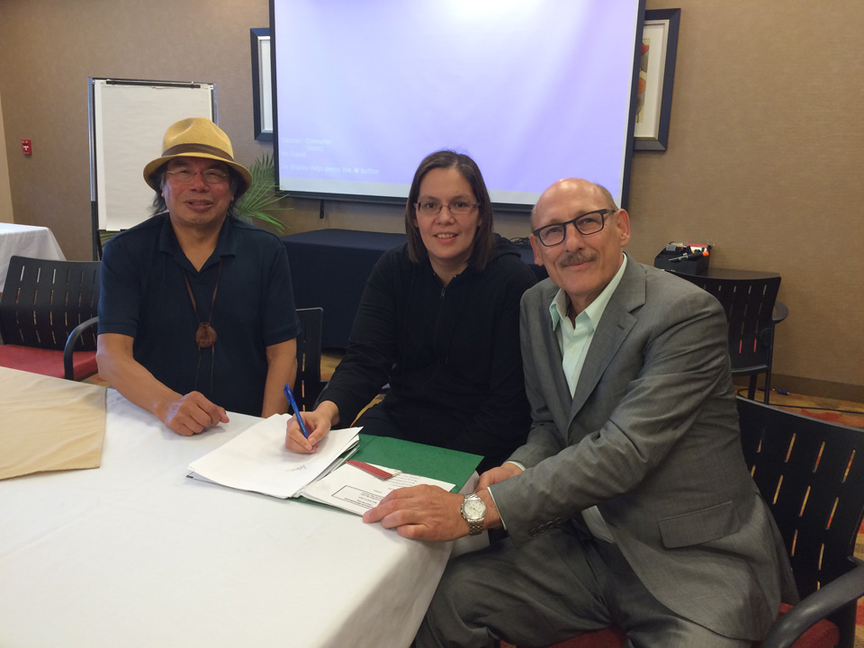 Geordi Kakepetum, CEO, NCC Development LP, Chief Vontaine Keno of McDowell Lake  and David Arenburg, Senior Advisor, Canadian Solar sign an agreement to install a 10 kW solar system in the small remote First Nation north of Red Lake, Ontario