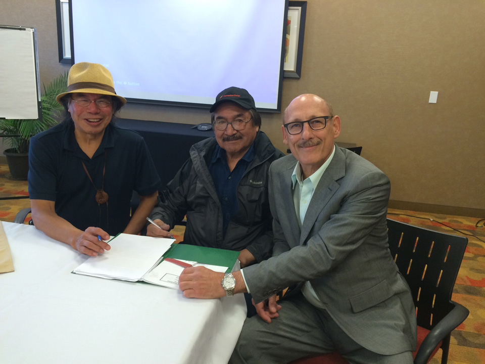 Geordi Kakepetum, CEO, NCC Development LP, Chief Joseph Crowe of Fort Severn First Nation near Hudson Bay and David Arenburg, Senior Advisor, Canadian Solar inking an agreement to install 300 kW solar / 300 kW storage with a controller solution