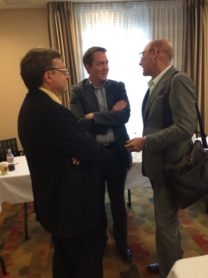 NCC corporate lawyer Ted Scollie, corporate accountant Jason Williams and David Arenburg, Senior Advisor, Canadian Solar discussing next steps after getting direction from the Chiefs who are served by NCC at the May 2015 Board meeting in Thunder Bay