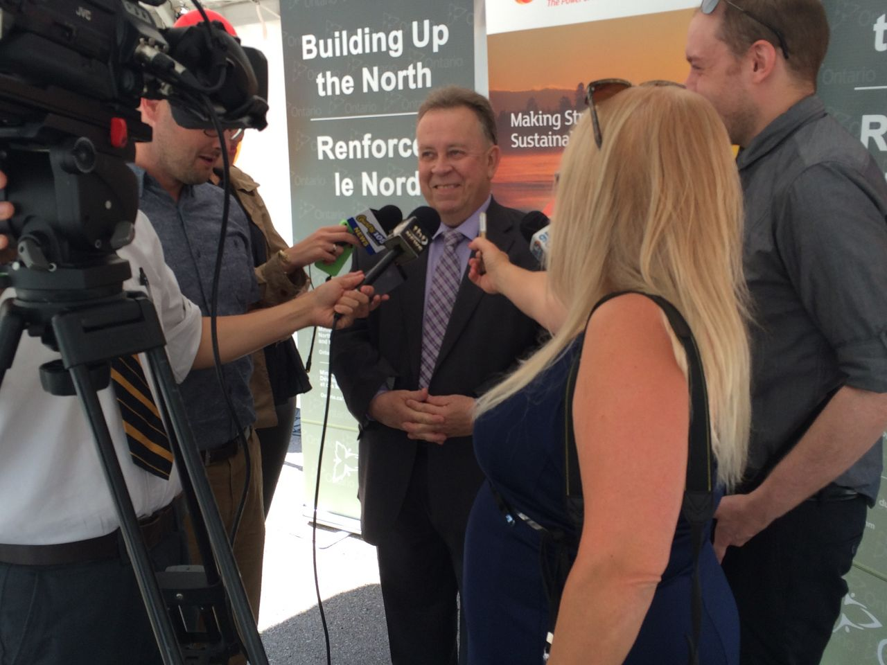 Minister Michael Gravelle speaks to the media about the Ontario governments massive investment in solar energy in fort severn First Nation
