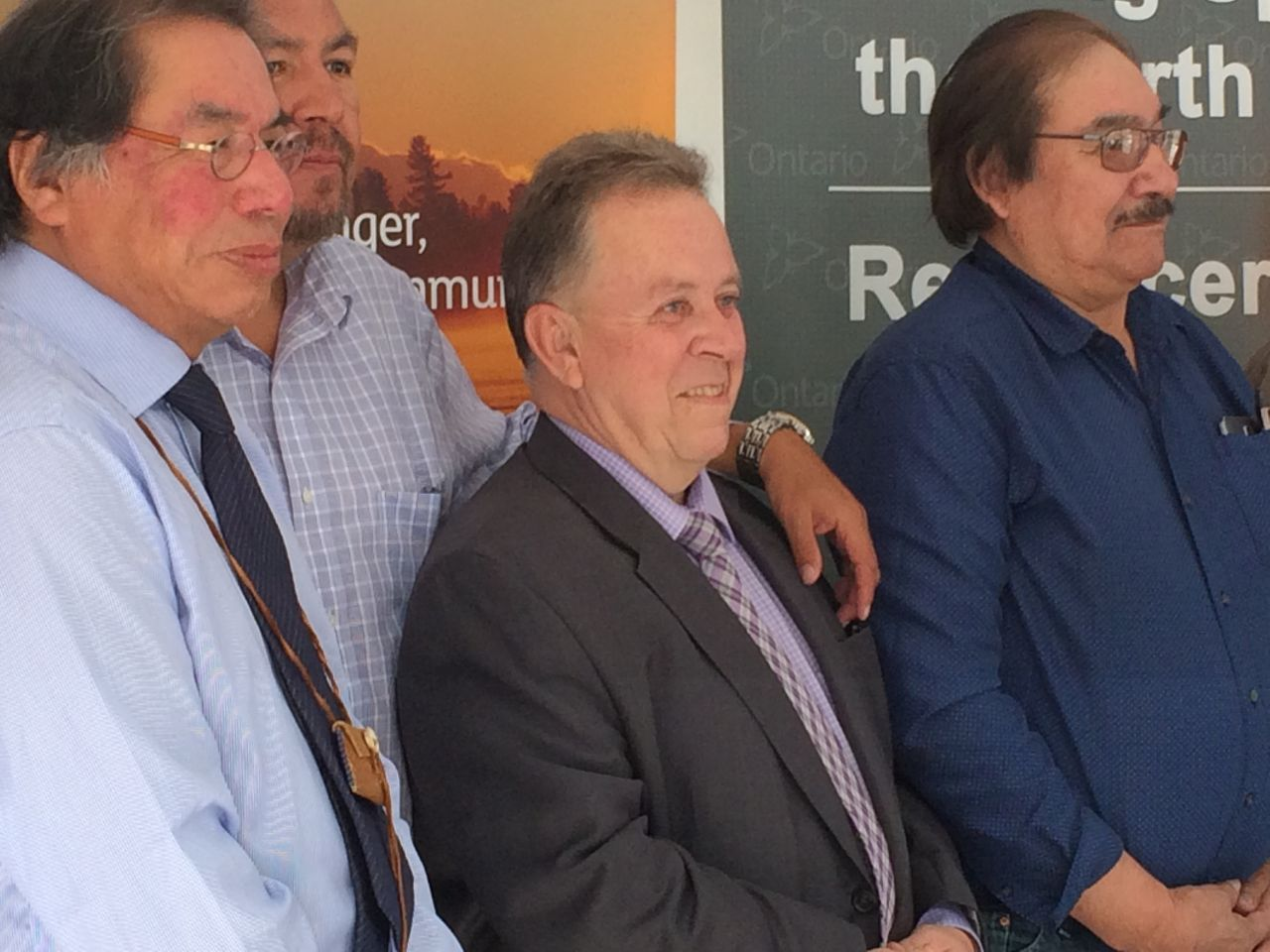 Geordi Kakepetum , Nan Deputy Grand Chief Terry Wabose, Ontario minister, the honourable Michael Gravelle and Chief Joseph Crowe of Fort Severn First Nation